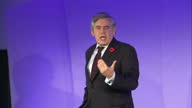 Shows interior shots Queen Elizabeth II Conference Centre in London with former British Prime Minister Gordon Brown speech soundbite on tax credits...