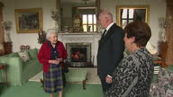 Shows interior shots Queen Elizabeth II meeting Governor General of Australia Sir Peter Cosgrove and his wife Lady Lynne Cosgrove and standing...