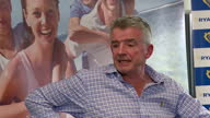 Shows interior shots Ryanair CEO Michael O'Leary at press conference speaking on damage to Ryanair reputation due to crewing scheduling mix up and...