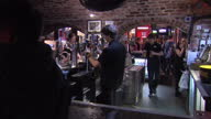 Shows interior shots steps into the Cavern Club audience at the bar listening to band on the stage on August 02 2015 in Liverpool England