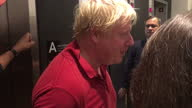 Shows interior shots UK Foreign Secretary Boris Johnson looking sweaty after being for a jog answering reporters questions on his disagreement with...