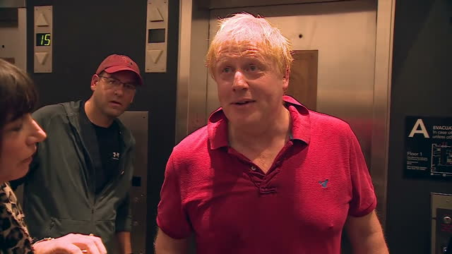 Shows interior shots UK Foreign Secretary Boris Johnson looking sweaty after being for a being ambushed by reporters near the lifts and answering...