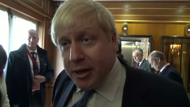 Shows interior shots UK Foreign Secretary Boris Johnson walking through a lobby answering reporters questions denying he made comments supporting...