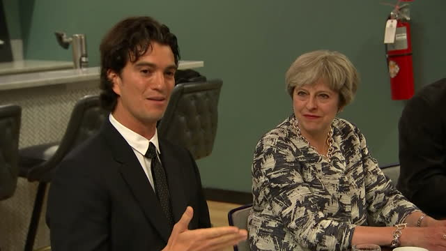 Shows interior shots UK Prime Minister Theresa May sitting listening to billionaire founder of Wework Shared Office Space Adam Neumann speaking about...