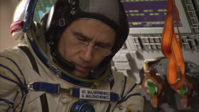 Shows Interior shots UK's ESA Astronaut Tim Peake dressed in spacesuit with fellow USA Astronaut Timothy Kopra and Russian Cosmonaut Yuri Malenchenko...