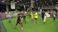 Shows interior shots various aged children participating in rugby taster session adn learning ball handling skills at free 'I am Team GB' event in...