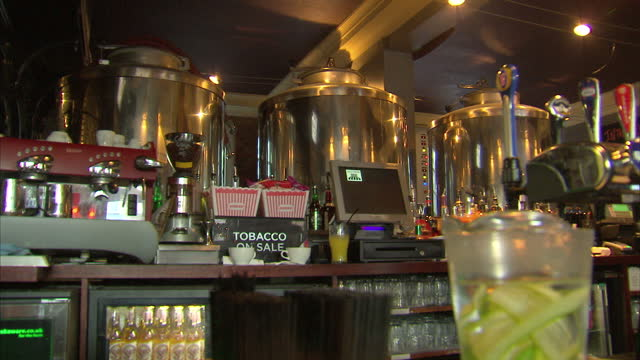 Shows interior shots vats containing craft beers behind bar and chalkboard advertising craft beer choices in pub on December 12 2016 in London England