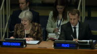 Shows interior shtos UK Prime Minister Theresa May and French President Emmanuel Macron arriving for and speaking during meeting at the UN General...