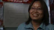 Shows Interview with Zin Mar Aung former political prisoner casting her first vote and posters supporting Aung San Suu Kyi As Myanmar heads to the...