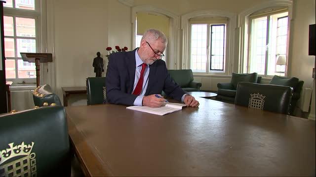 Shows Jeremy Corbyn MP working in office
