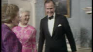 Shows Margaret Thatcher George H W Bush Barbara Bush and Dennis Thatcher greet dinner guests in file line including Neil Kinnock Labour Leader and...