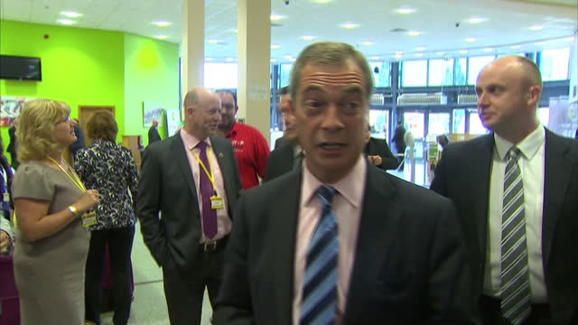 Shows Nigel Farage leader of Ukip party arriving at conference shaking hands and taking some questions form the media at Doncaster Racecourse on...