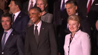 Shows President Barack Obama posing for 'Family Photo' with NATO Secretary General Anders Fogh Rasmussen and Lithuanian President Dalia Grybauskaite...