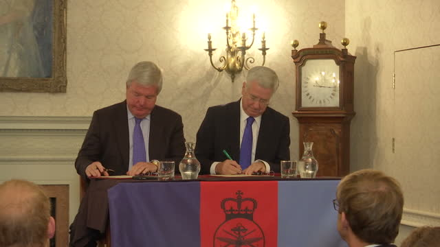 Shows Sir Michael Fallon Secretary of State for Defence and the Chair of the Royal Foundation Keith Mills signing Mental Health Partnership document...