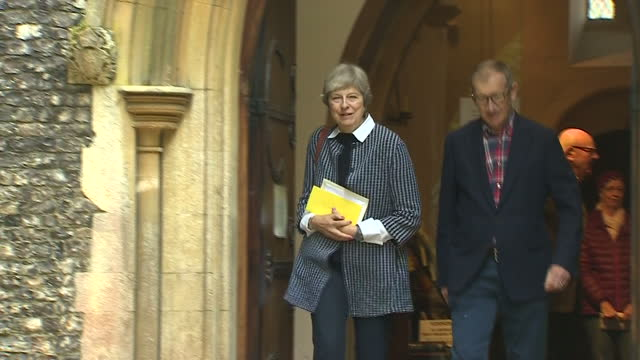 Shows the arrival and departure of UK Prime Minister Theresa May and her husband Philip May who attended Sunday morning service at a church in her...