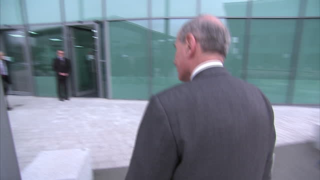 Shows The coroner Lord Justice Goldring walk out of building pose for snappers On April 01 2014 in Liverpool England