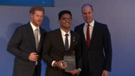 Shows the Duke of Cambridge and Prince Harry presenting award to Amaan Iqbal Ibrahim who has supported 1000 labourers in United Arab Emirates who...