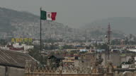 Shows wide shots of the city with the TransMexican mountain range in the background and the Mexican flag flying on December 12 2014 in Mexico City...