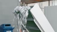 LD Shredded paper falling from conveyor belt of industrial shredder