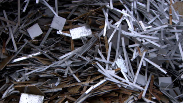 Shredded paper lies in a pile.