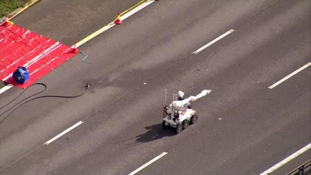 Bomb disposal closes motorway Aerial GVs ENGLAND Buckinghamshire M1 Bomb disposal robot driving along M1 motorway towards suspicious package / Robot...