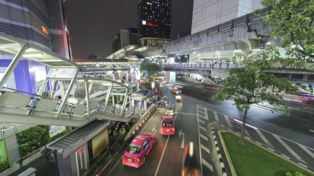 WS T/L Siam city centre at night showing busy roads with traffic / Bangkok, Thailand