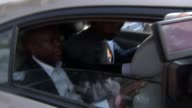 Arthur SimpsonKent appears in court GHANA Accra EXT Car arriving at court SimpsonKent and others in back of car SimpsonKent arriving at court with...