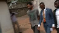 Arthur SimpsonKent admits to murders T12011633 / TX GHANA Accra EXT SimpsonKent handcuffed and arriving at court
