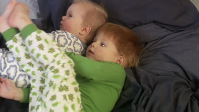 Siblings in bed, Sweden.