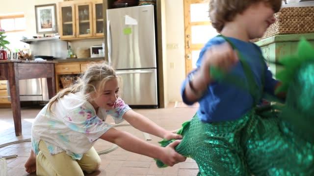 siblings playing at home
