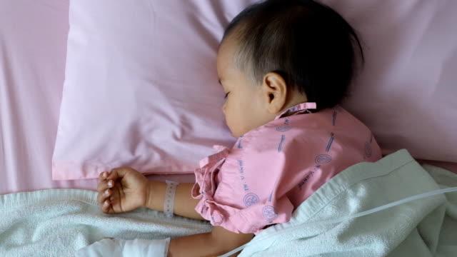 Sick Asian boy sleeping and nebulizer