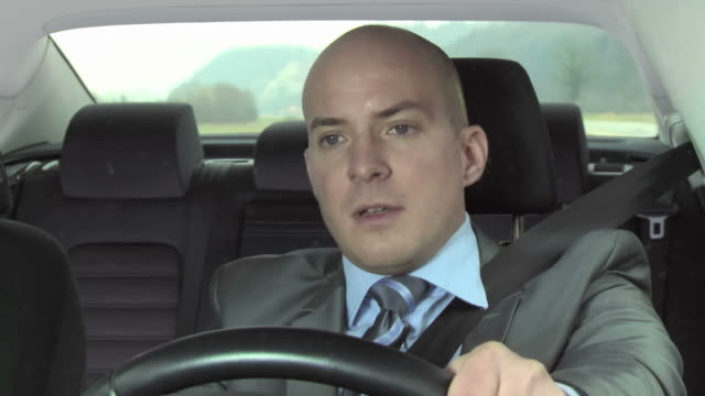 HD: Sick Businessman Driving The Car