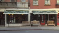 MS side by side restaurants with awnings / New York, New York, USA