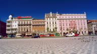 Side car point of view past base of statue in Marques do Pombal Square / buildings in background / Lisbon, Portugal