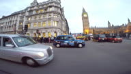 Side POV driving in Central London in the early evening.