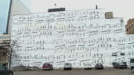 A side of a building painted with musical notes, located on Marquette avenue in Minneapolis Minnesota