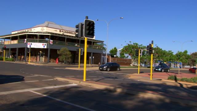 MS SLO MO Side POV Shot of Driving through town / Coolgardie and Kalgoorlie, Western Australia, Australia