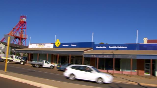 MS Side POV Shot of Driving through town / Coolgardie and Kalgoorlie, Western Australia, Australia