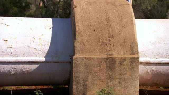 CU Side POV Shot of Pipe / Coolgardie and Kalgoorlie, Western Australia, Australia