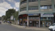 MS Side POV Shot of Shops on road side / Addis Abbaba, Ethiopia