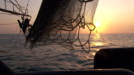 MS Side POV Shot of Trawler net and mast sun on horizon / Northern Territory, Australia