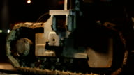 CU Side view of continuous track of road resurfacing vehicle as it moves along a road at night, Cape Town, South Africa