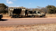 Side View Two Animal Transfer Vehicles along road Rhino poaching is a major threat to the extinction of rhinos living in and around nature reserves...