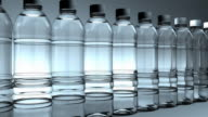 Side view, Water bottles slowly moving (Loop)