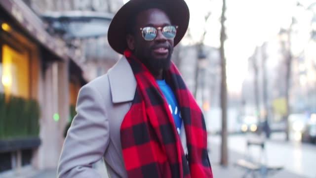 Sidya Sarr is wearing a Zara coat a Zara scarf Nike Blazer shoes HM blue denim jeans a Rad blue sweater 'Premier de la Classe' a Zara hat and Rayban...