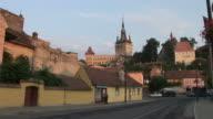 SighisoaraLong view of Citadel Clock Tower in Sighisoara Transylvania Romania