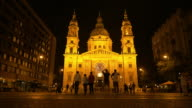 Sightseers Moving In Front Of St. Stephen's Basilica In Budapest