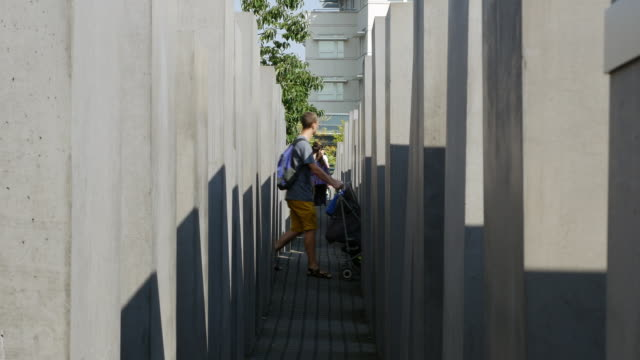 Sightseers visiting the Memorial to the Murdered Jews of Europe in Berlin on sunny september day Shot in 4K/UltraHD ProRes 422 downconverted to HD