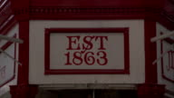 A sign above Kirkgate Market indicates establishment in 1863. Available in HD.