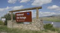 MS PAN Sign board of national elk refuse / Jackson Hole, Wyoming, United States
